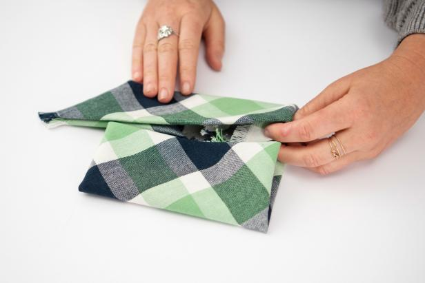 This pinwheel-shaped napkin is sure to impress your guests this holiday season.