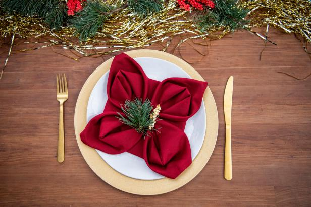 Impress your guests this Christmas with a festive poinsettia folded napkin.