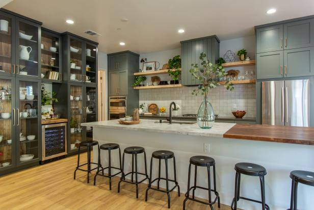 Neutral Kitchen Featuring Green Cabinets with Glass Doors