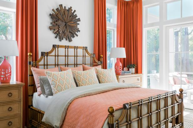White Coastal-Style Master Bedroom With Coral-Colored Accents