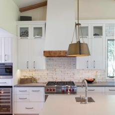 White Chef Kitchen With Wood Beams