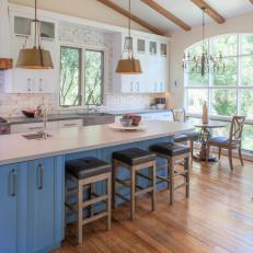 Cottage Eat In Kitchen With Blue Cabinets