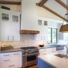 Cottage Chef Kitchen With Wood Beams