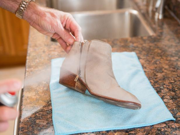 Spraying suede boots with suede protector