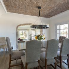 Mediterranean Dining Room With Brick Ceiling