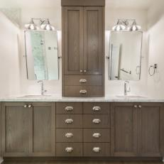 Neutral Bathroom With Silver Sconces