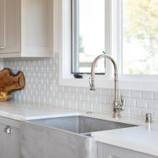 Kitchen Sink and Beveled Tile Backsplash