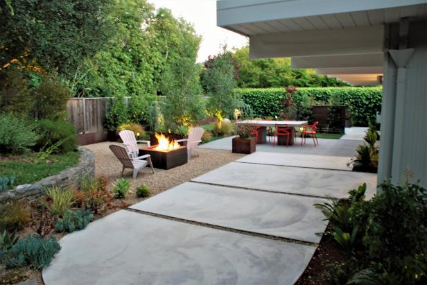 Lengthy View Of Patio With Concrete Paver Walkway To Concrete Table