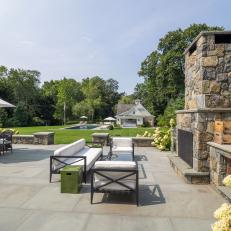 Extensive Patio With Grand Stone Fireplace