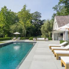 Lengthy, Modern Swimming Pool With Blue Pebble Finish