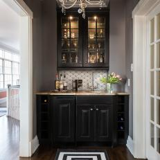 Elegant Wet Bar With Ornate Chandelier