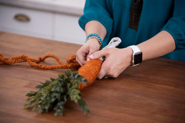 Wrap the dyed twine around the top of the carrot, using a glue gun to secure into place, and continue all the way down.