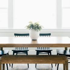 Wood Dining Table with Matching Bench and Black Chairs in White Breakfast Nook