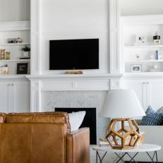 White Living Room with Fireplace, Built-in Shelves and Cabinets