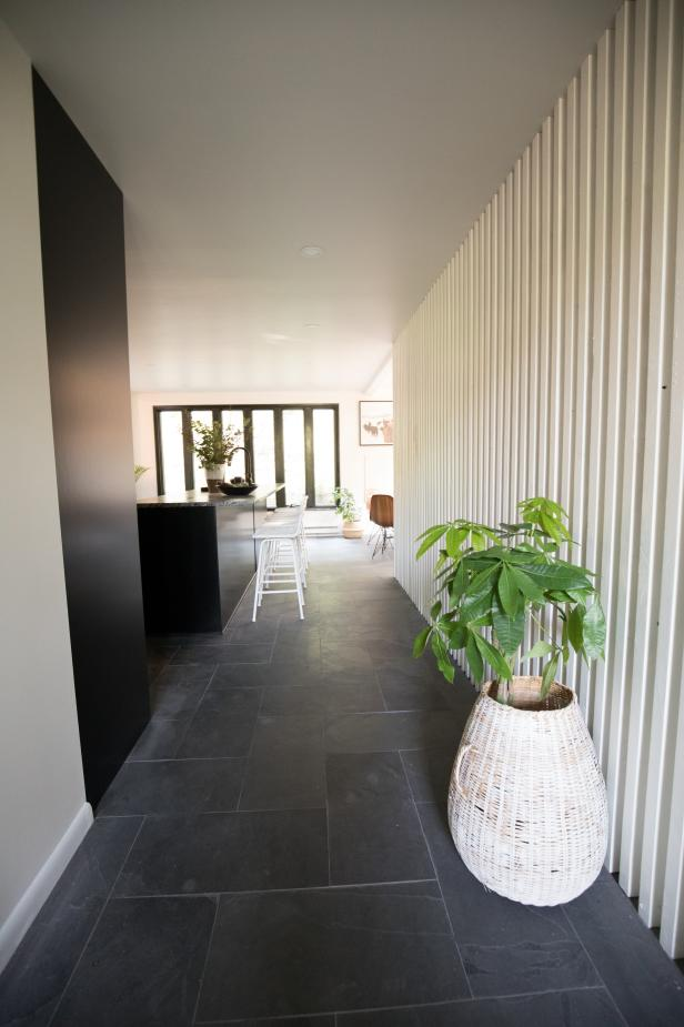 Black and White Hallway with White Slat Wall