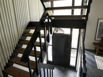 Modern Black Stairway with Black Railing