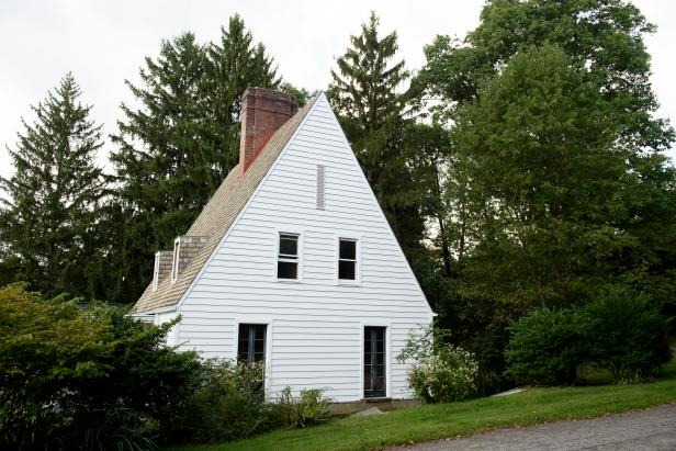 White Home Exterior  with Brown Brick Chimney