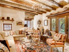 Southwestern Living Room With Wood Beams, Painted Ceilings