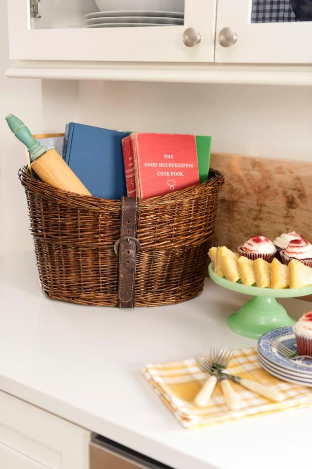 Give a new basket old-school charm with a leather belt and dark stain, then use it to handily corral cookbooks in your kitchen.
