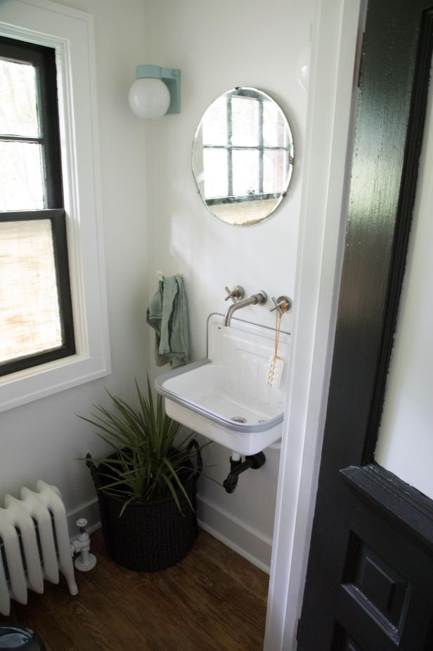 White Powder Room with Round Mirror, White Sink