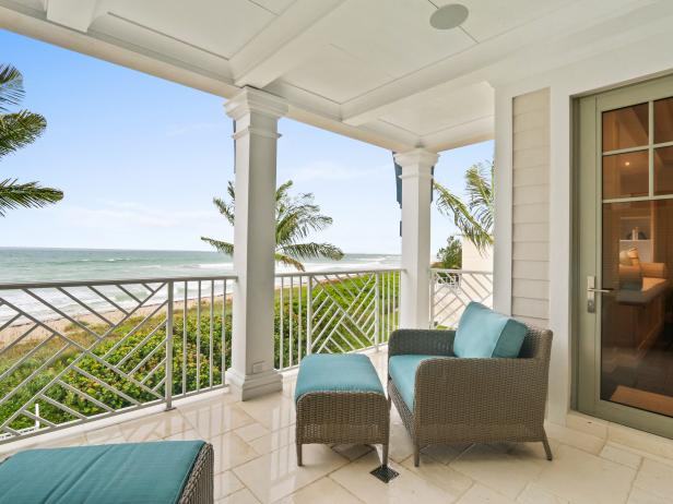 Oceanfront Porch With Blue Armchair