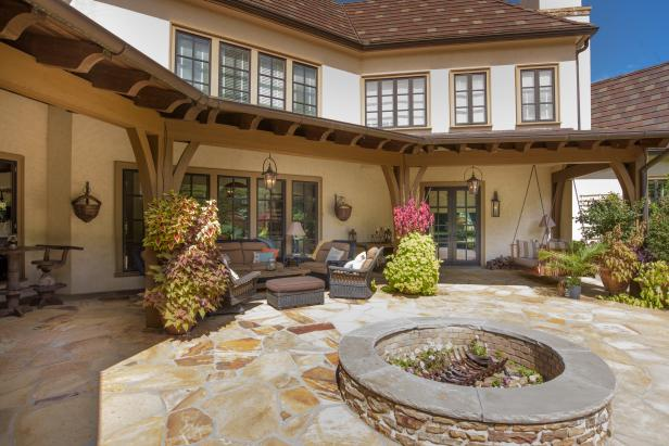 French Country Style Mansion Back Covered Patio and Stone Fire Pit