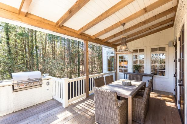 Covered Porch With Built-In Grill and Dining Table