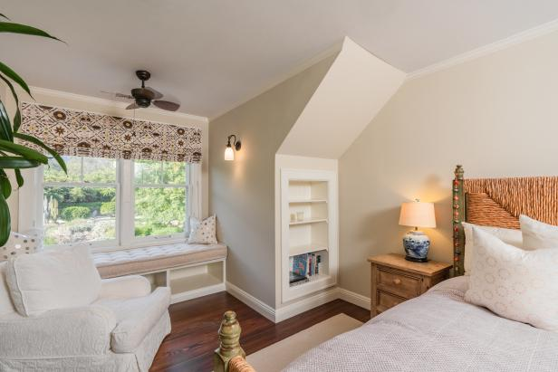 transitional guest bedroom with window seat