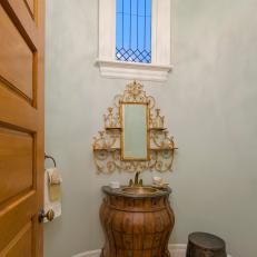 Powder Room With Gold Decor Tucked Away in Turret
