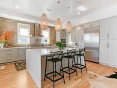 Neutral Open Plan Kitchen With Basket Pendants