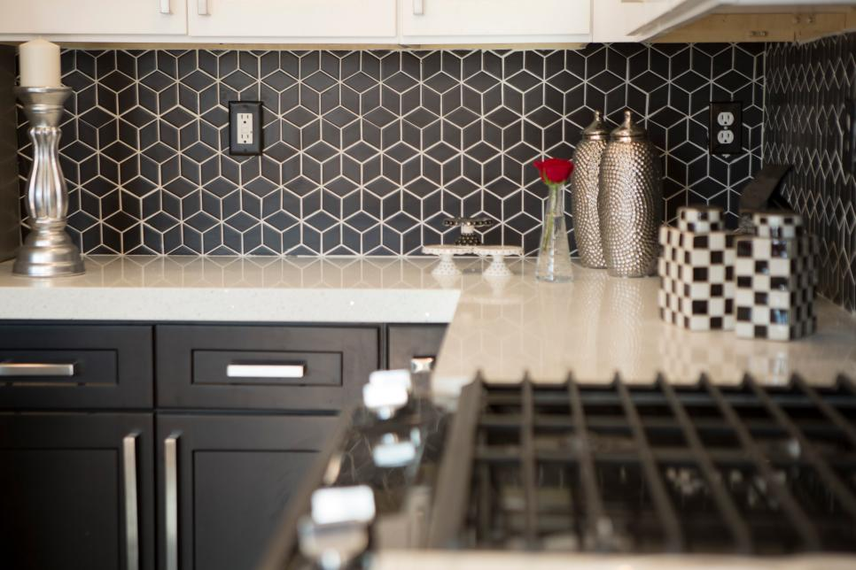 Modern Black Kitchen With Black And White Tile Backsplash Hgtv