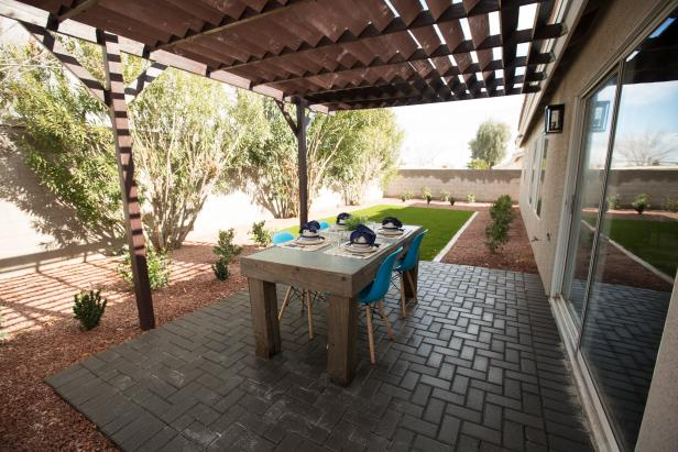 Neutral Patio with Brown Wooden Table and Blue Chairs