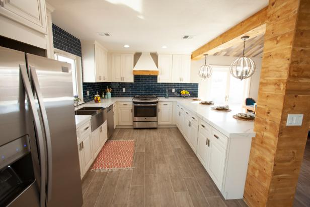 Neutral  Kitchen with Blue Tile Backsplash and White Cabinets