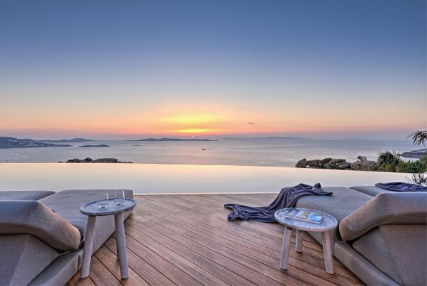 View of the Sea at Sunset from Lounge Chairs by Infinity Pool