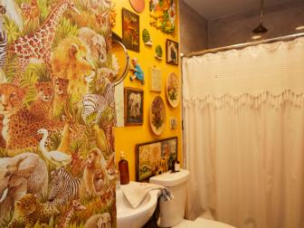 Bright Yellow Bathroom Walls Are Filled With Eclectic Art