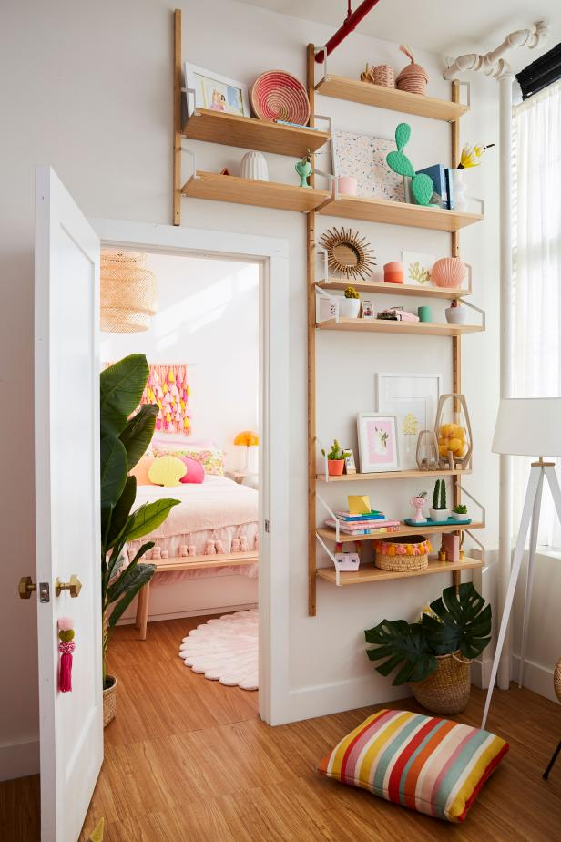 A Wall-Mounted Shelving Unit Is Filled With Colorful Accessories