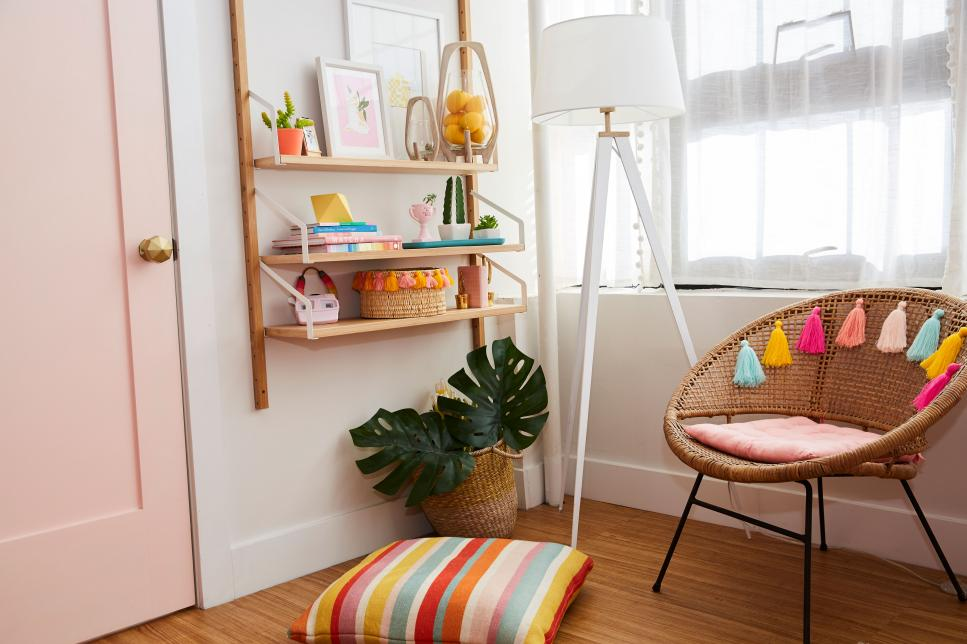 Colorful Accessories Sit on a Wood Shelf Next to a Wicker Chair