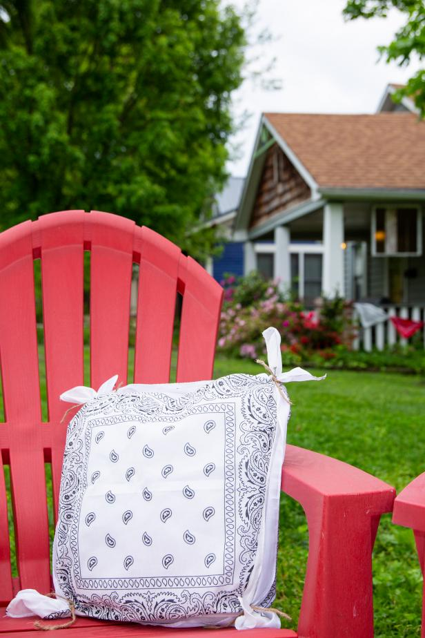 A Red Chair With a Patriotic Pillow Crafted From a Bandana