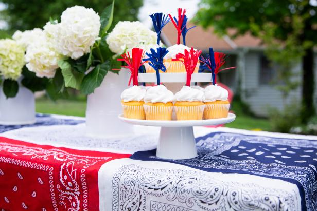 A Tower of Cupcakes Sits On a Patriotic Bandana Tablecloth