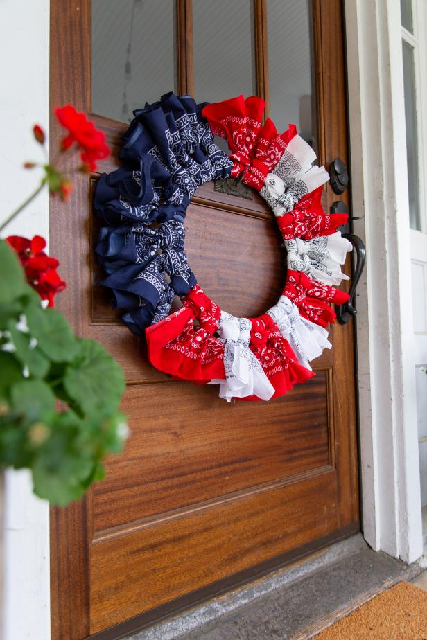 A Wooden Door Decorated With a Patriotic Bandana Wreath