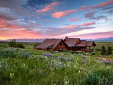 Log Cabin Mansion Takes in Montana Sunset View