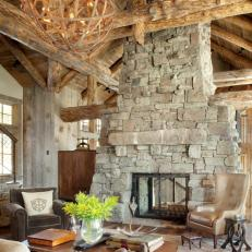 Elegant Rustic Stone Fireplace With Wooden Chandelier