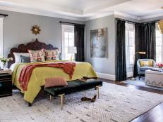 Gray Eclectic Master Bedroom With Orange Throw