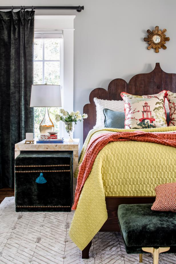 Eclectic Bedroom With Orange Throw