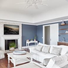 Blue Coastal Living Room With Shiplap Walls