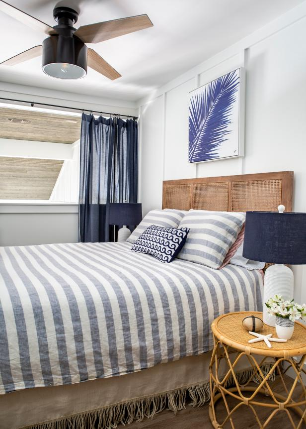 Blue Bedroom With Feather Art