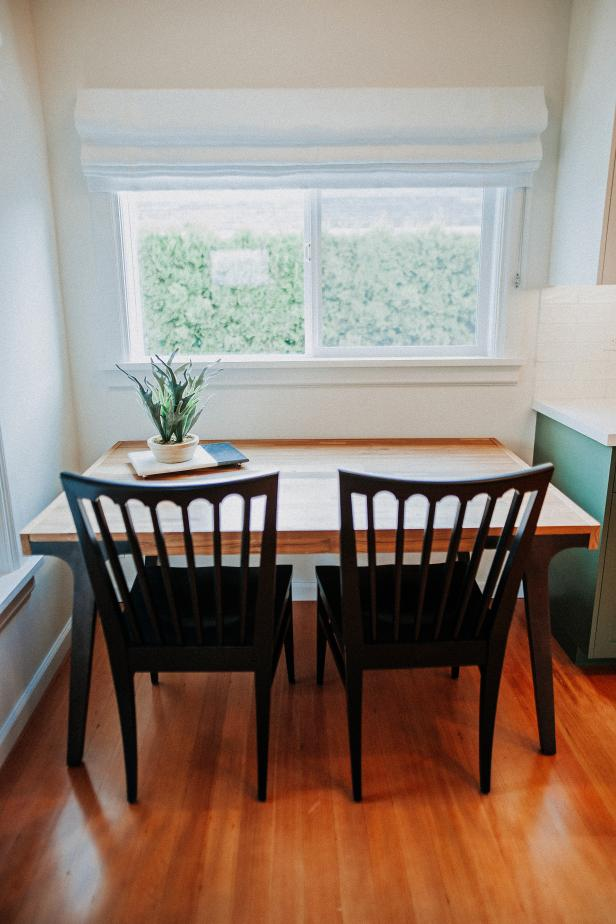 Small Dining Table With Two Chairs Sit In Front Of Large Window