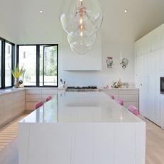 White Chef Kitchen With Bubble Pendants