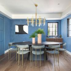 Blue Dining Room With Brass Chandelier