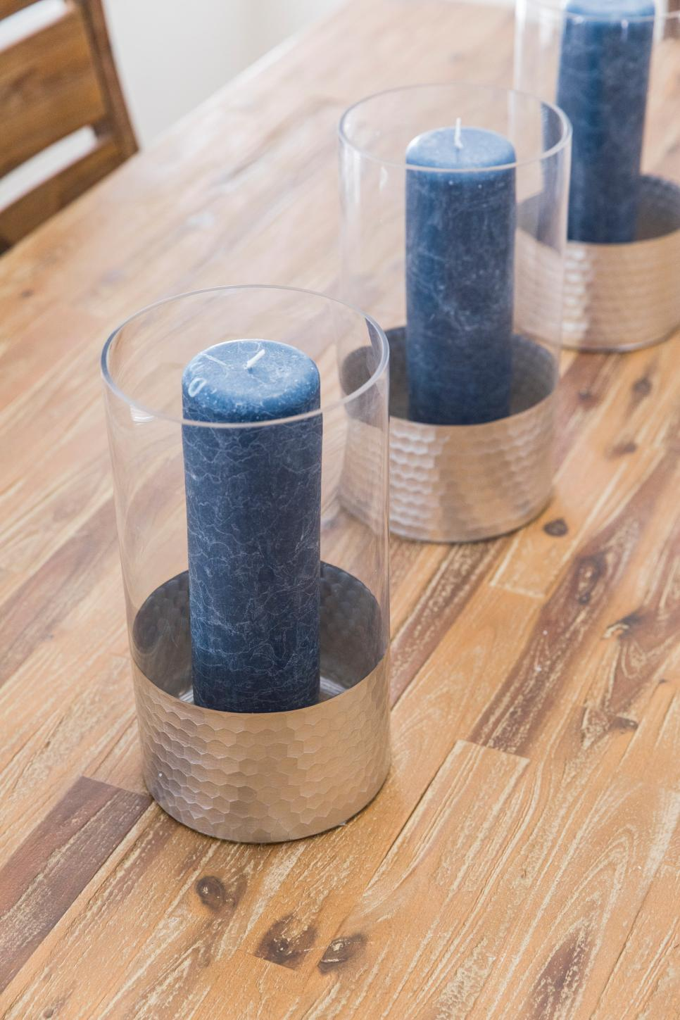 Blue Candles on a Neutral Wood Dining Table